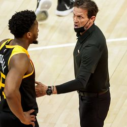 Utah Jazz head coach Quin Snyder talks to guard Donovan Mitchell (45) during the game against the Oklahoma City Thunder at Vivint Smart Home Arena in Salt Lake City on Tuesday, April 13, 2021.