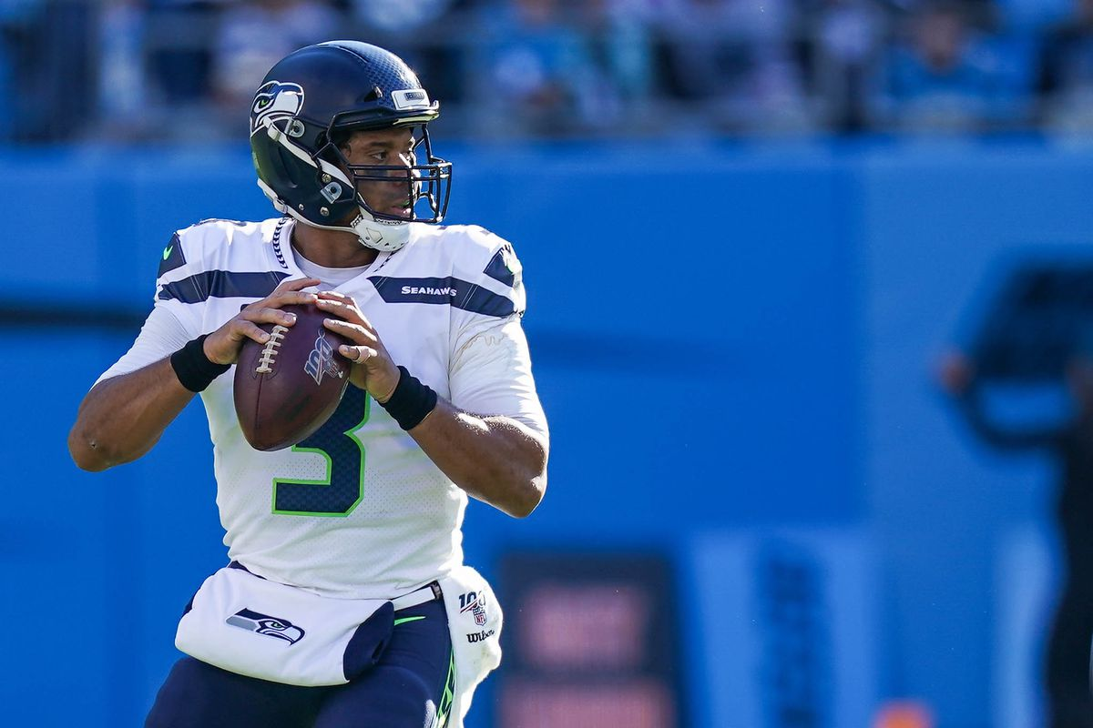 Seattle Seahawks quarterback Russell Wilson drops back to pass against the Carolina Panthers during the second quarter at Bank of America Stadium.