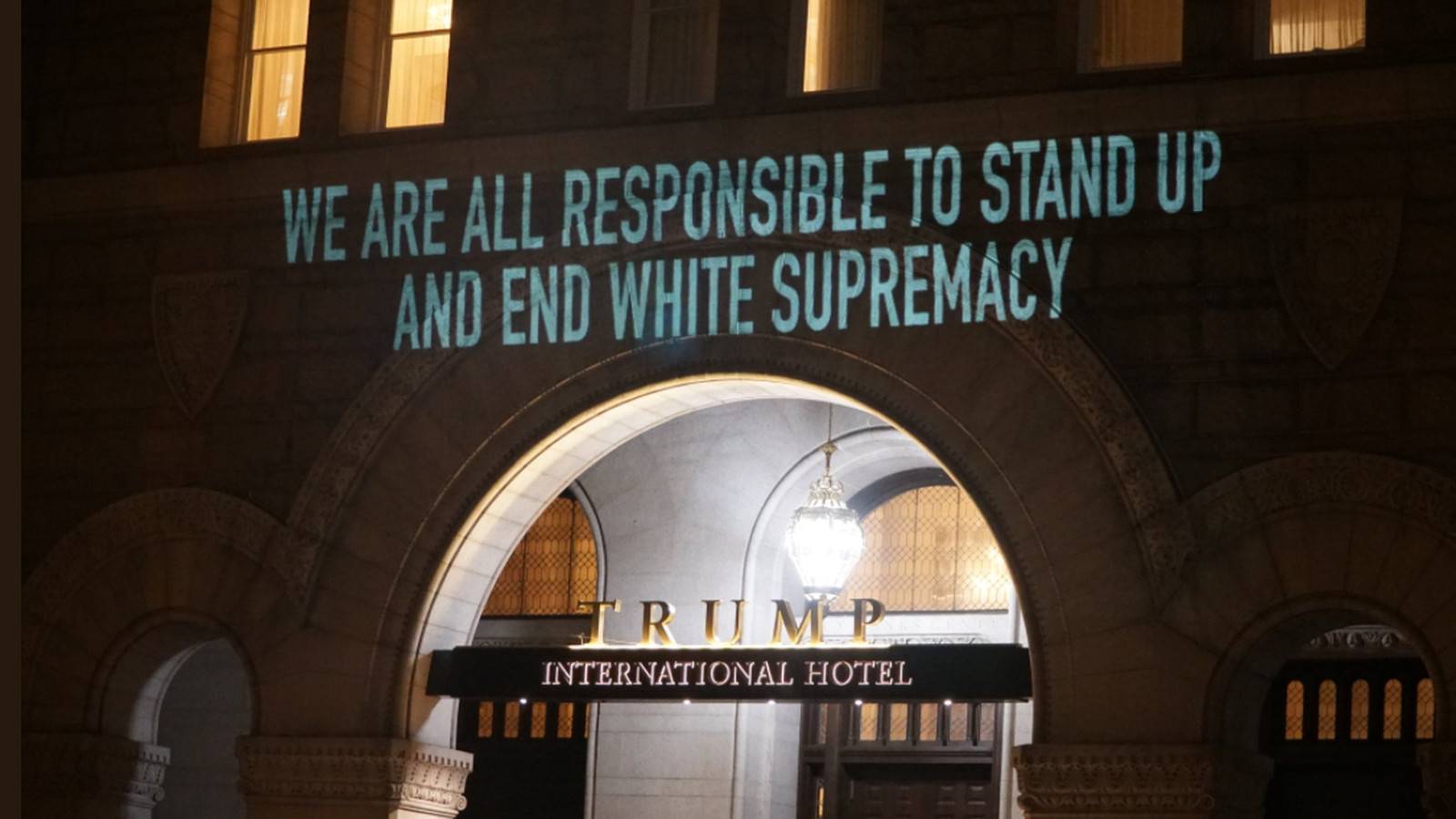Anti Trump Messages Projected On D C Hotel Newseum