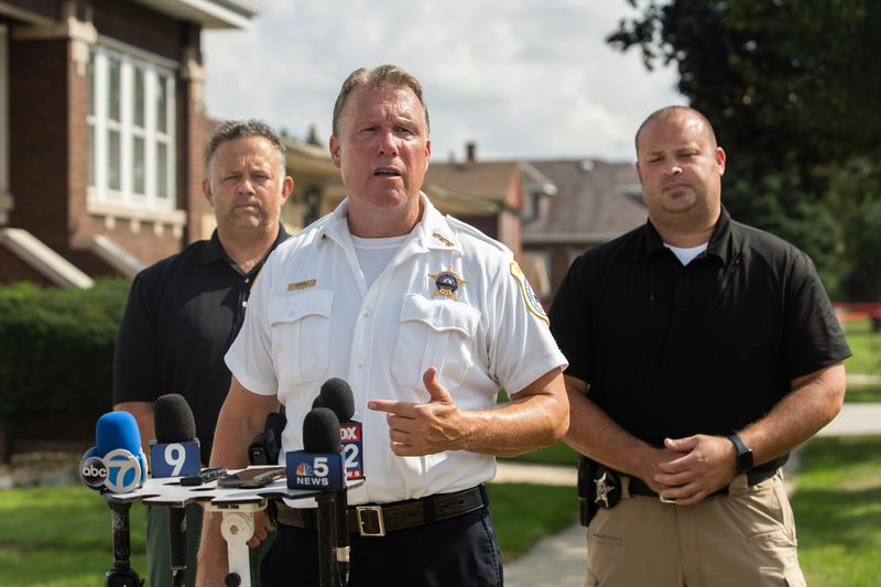 Lyons Police Chief Tom Herion talks to the media Saturday after investigators found the remains of two bodies in the back yard of the home of two brothers who said they buried their mother and sister there, in the 3900 block of Center Avenue in Lyons. The brothers were taken into custody Saturday afternoon, but no charges have been filed.