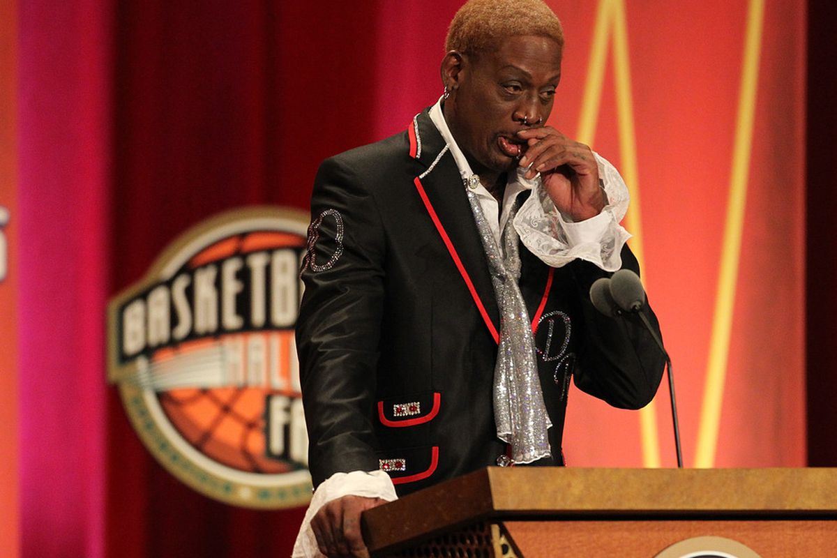 SPRINGFIELD, MA - AUGUST 12:   Dennis Rodman reacts during the Basketball Hall of Fame Enshrinement Ceremony at Symphony Hall on August 12, 2011 in Springfield, Massachusetts. (Photo by Jim Rogash/Getty Images)