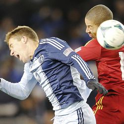 Kansas City's Matt Besler and Real's Alvaro Saborio head the ball as Real Salt Lake and Sporting KC play Saturday, Dec. 7, 2013 in MLS Cup action. Sporting KC won in a shootout.