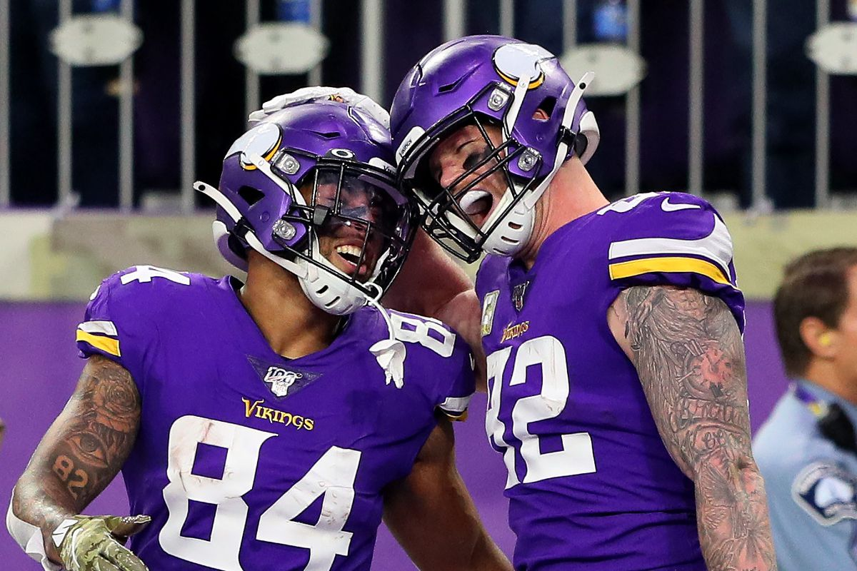 Irv Smith Jr. #84 and Kyle Rudolph #82 of the Minnesota Vikings celebrate a touchdown in the fourth quarter against the Denver Broncos at U.S. Bank Stadium on November 17, 2019 in Minneapolis, Minnesota.