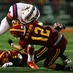 Batavia's Sam Barus (12) puts a hit on East St. Louis' DaMonta Witherspoon.