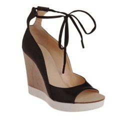 "<a href=""http://www.barneyswarehouse.com/on/demandware.store/Sites-BNYWS-Site/default/Product-Show?pid=501513509&cgid=womens&index=18""><b>Jil Sander</b> Wedge Sandal</a>, $239 (were $595)"