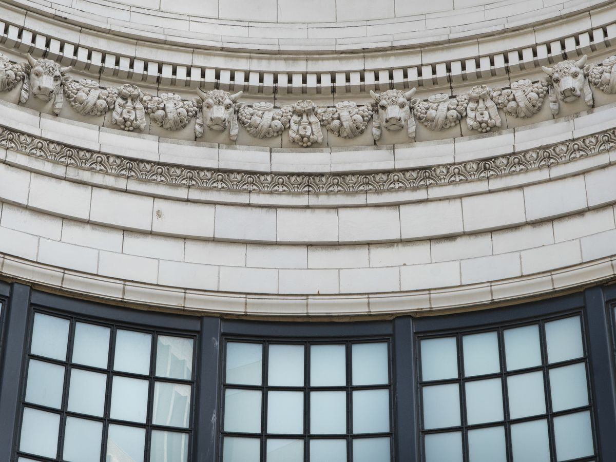 Architectural detail of the Coliseum Theater in Seattle. The wall design features minotaurs and fruit baskets sculpted out of terracotta.