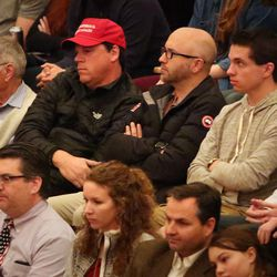 A man wearing a Trump hat listens to Mitt Romney, former governor of Massachusetts, address the Hinckley Institute of Politics regarding the state of the 2016 presidential race during a speech at the University of Utah in Salt Lake City on Thursday, March 3, 2016.