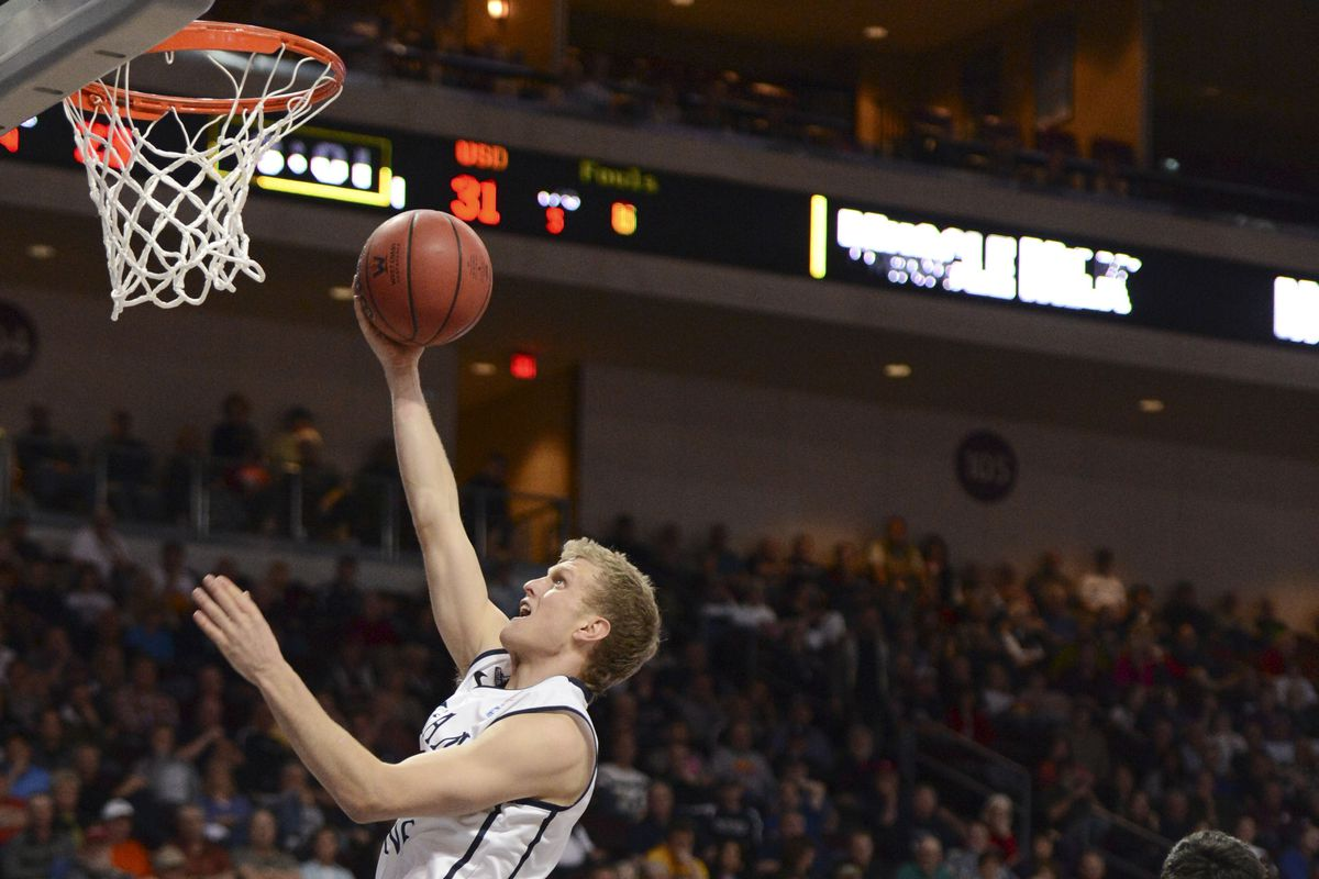 Haws goes up for a layup
