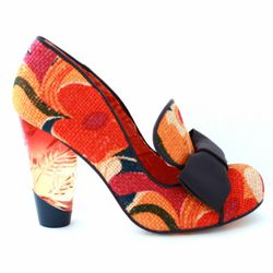 This shoe looks like something Miuccia Prada might have designed for Anthropologie…after she'd gone on a 3-day meth bender. Still,  these have that jolie laide thing going on. Too bad these don't light up like a number of the other lucite heels from Irr