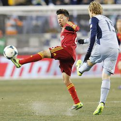 Real's Sabastian Velasquez tries to knock down the ball by Kansas City's Seth Sinovic as Real Salt Lake and Sporting KC play Saturday, Dec. 7, 2013 in MLS Cup action. Sporting KC won in a shootout.
