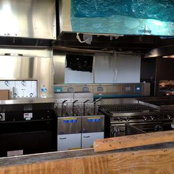 <em>The kitchen has been designed with multiple pick-up stations to handle volume.</em>