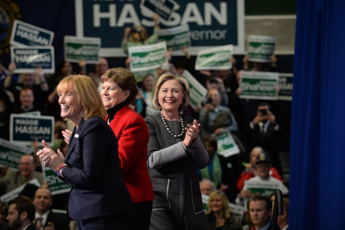 Former U.S. Secretary of State Hillary Clinton (R) campaigns with U.S. Senator Jeanne Shaheen (D-NH) and New Hampshire Governor Maggie Hassan (L) at Nashua Community College November 2, 2014 in Nashua, New Hampshire.