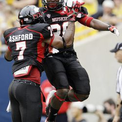 Northern Illinois running back Keith Harris, Jr. (20) celebrates with wide receiver Perez Ashford (7) after scoring a touchdown during the first half of an NCAA college football game against Iowa at Soldier Field in Chicago, Saturday, Sept. 1, 2012.