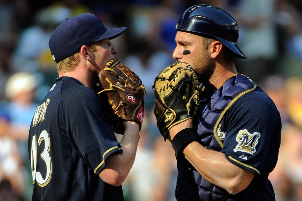 July 4, 2012; Milwaukee, WI, USA;  Milwaukee Brewers pitcher Randy Wolf (43) and catcher George Kottaras (9) talk on the mound in the seventh inning during the game against the Miami Marlins at Miller Park.  Mandatory Credit: Benny Sieu-US PRESSWIRE