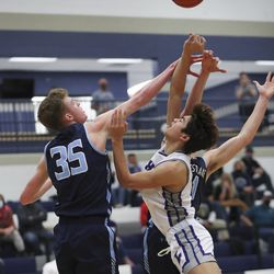 Westlake's Hunter Phillips (35) blocks the shot by Lehi's Peter Amakasu (20) in a tournament at Corner Canyon High School in Draper on Thursday, Dec. 3, 2020.