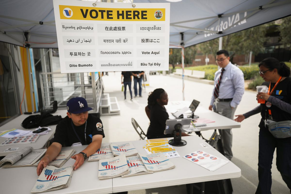 A voter checks in before entering a voting booth during early voting for the 2020 California presidential primary election ahead of Super Tuesday.