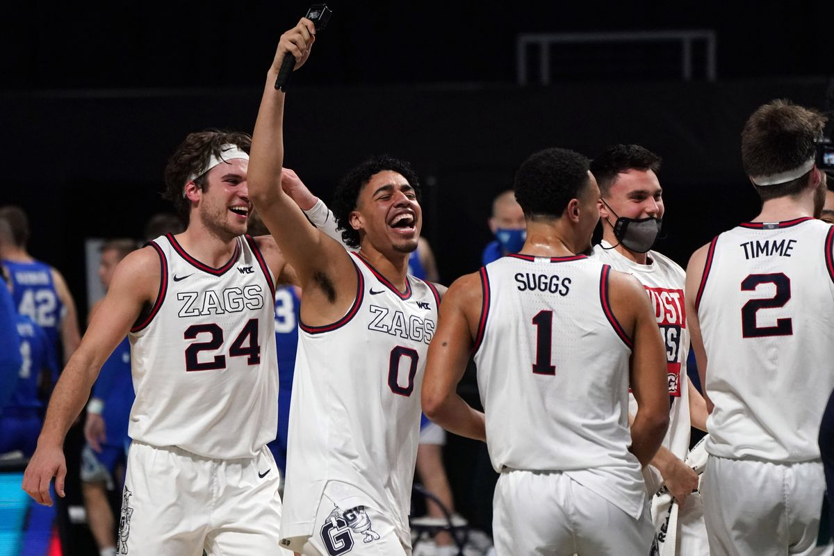 Gonzaga Bulldogs forward Corey Kispert, guard Julian Strawther, guard Jalen Suggs and forward Drew Timme celebrate after defeating the the BYU Cougars in the West Coast Conference Tournament championship game at Orleans Arena.