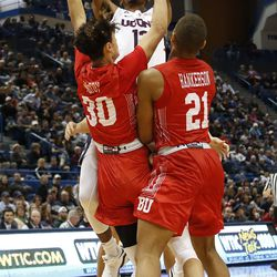 UConn's Tyler Polley (12) puts up a shot over two Boston University defenders.
