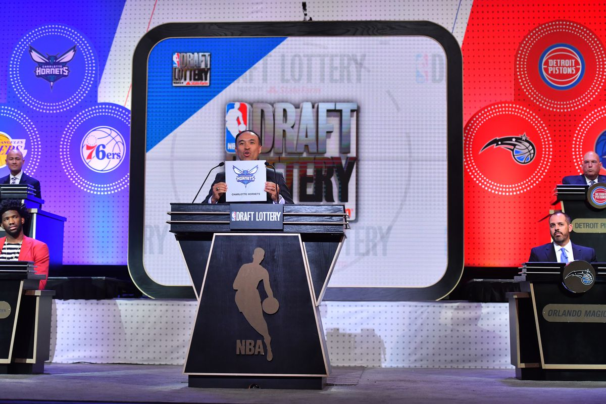 Deputy Commissioner of the NBA, Mark Tatum announces the Charlotte Hornets 11th pick during the 2017 NBA Draft Lottery at the New York Hilton in New York, New York.