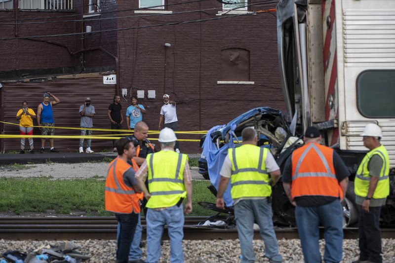 Metra police and engineers investigate the site at  103rd Street and Vincennes Avenue after a train collided with a vehicle killing 3 occupants Sunday, June 27, 2021.