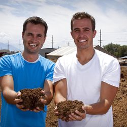 """Daniel Blake and Craig Martineau, co-founders of EcoScraps, hold some of the compost made due to the business they began in 2010. Blake and Martineau were helped by an economic self-reliance program at BYU, which was honored as a """"Changemaker Campus"""" Monday by Ashoka U."""