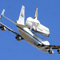 The retired shuttle Endeavour piggy-backs a modified Boeing 747 Shuttle Aircraft Carrier during its final flight Thursday, Sept. 20, 2012 as the pair soar over White Sands Missile Range east of Las Cruces, N.M, before reaching their landing destination in California.