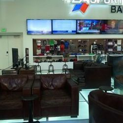 The bar at EA Sports Bar is now a wall with items for sale.