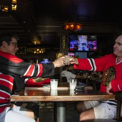 Chicago Blackhawks fans Jim Moore, left, and Tony Vittal enjoy a drink at WestEnd near Madison St and Ada St ahead of the Blackhawks game against the Edmonton Oilers, Friday, Aug. 7, 2020. | Tyler LaRiviere/Sun-Times