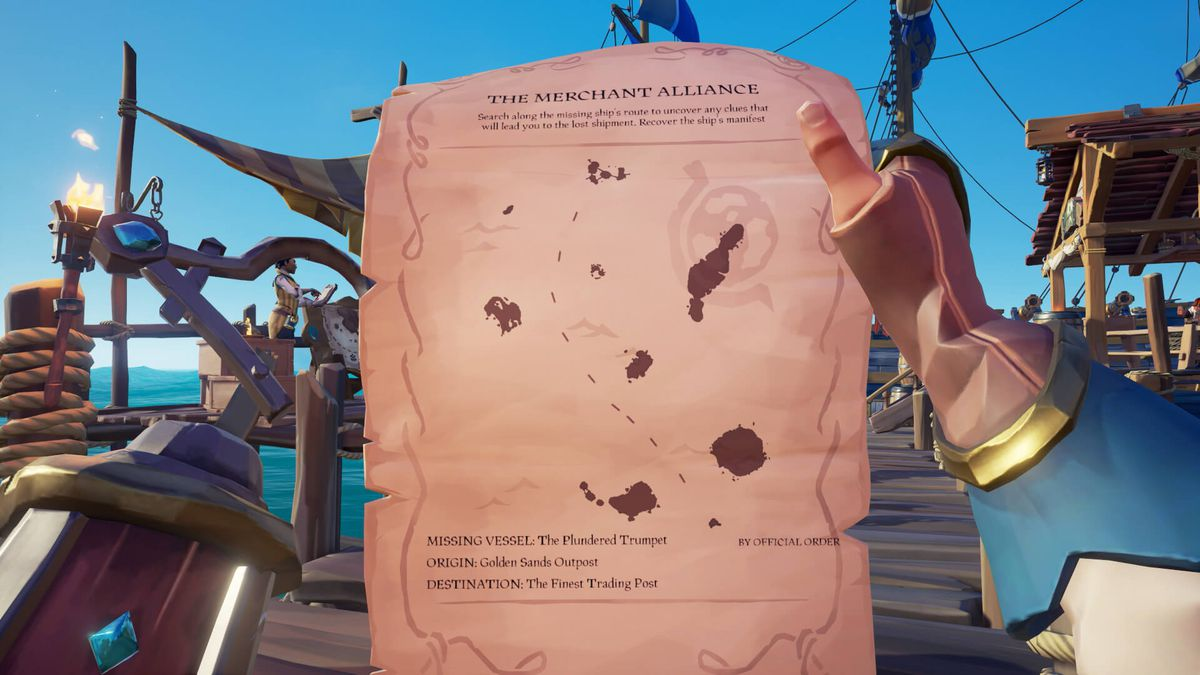 Sea of Thieves - a player investigates a map from the Merchant Alliance, which shows the location of some lost treasure.