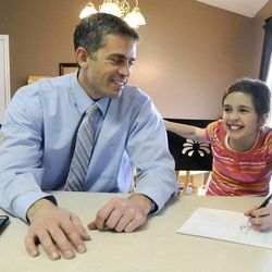 Jeff Griffin helps his daughter Savanna, 10, with her times tables after school in their home in West Jordan on Thursday, Feb. 27, 2014.