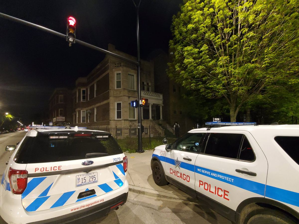 Chicago police investigating the scene where a person was shot and killed in the 3300 block of West Douglas.   Tyler LaRiviere