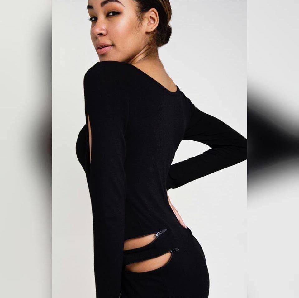 A model in a black dress