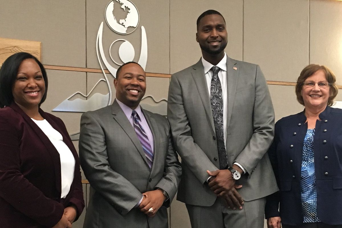 Four new board members, Kyla Armstrong-Romero, Marques Ivey, Kevin Cox and Debbie Gerkin after they were sworn in. (Photo courtesy of Aurora Public Schools)