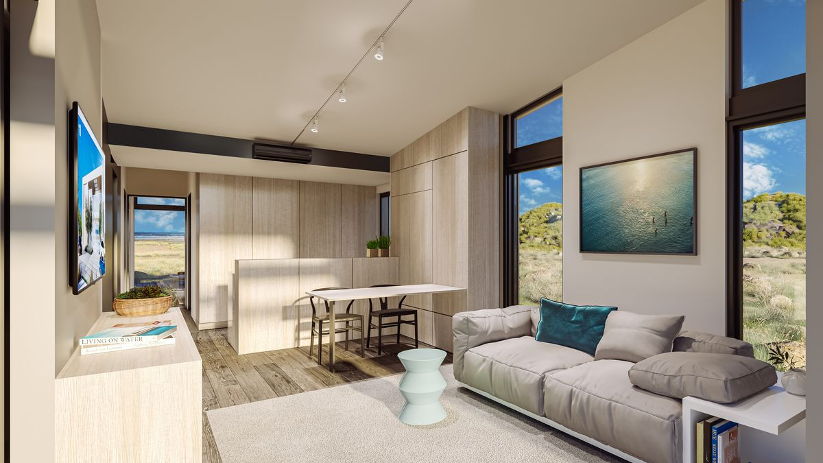 Rendering of interior of a home with light wood furnishings and windows overlooking a beach.