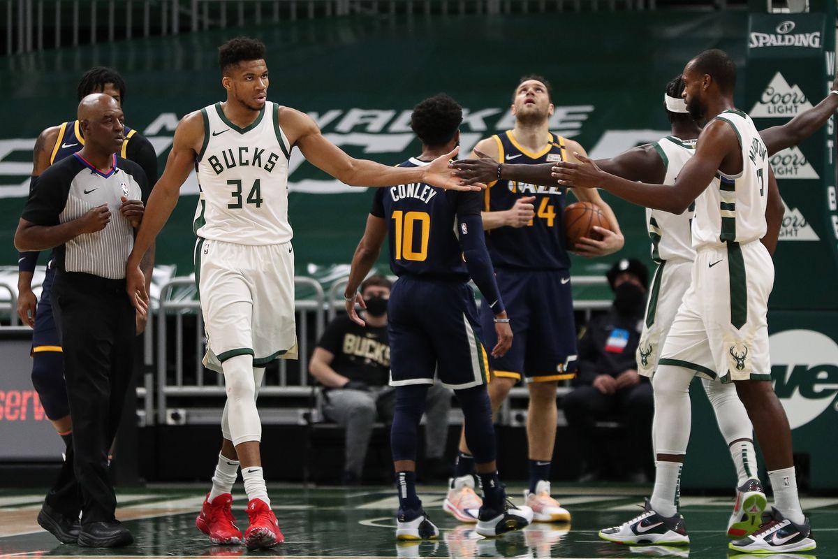 Milwaukee Bucks forward Giannis Antetokounmpo (34) celebrates with forward Khris Middleton (22) against the Utah Jazz at the Bradley Center.