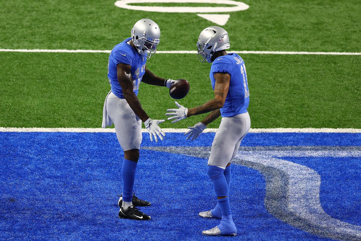 Mohamed Sanu #12 of the Detroit Lions celebrates a touchdown with Marvin Jones #11 during the second half of a game against the Houston Texans at Ford Field on November 26, 2020 in Detroit, Michigan.