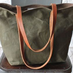 """Allston's <a href=""""http://www.forestbound.com/"""">Forestbound</a> is all about handcrafted tote bags made from reclaimed materials."""