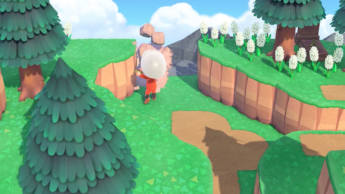 A villager smashes rocks with a shovel in a screenshot from Animal Crossing: New Horizons.