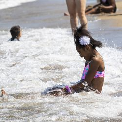 Skye Bronson, 10, of the South Shore neighborhood, plays in the waves of Lake Michigan at 31st Street Beach on the South Side, Wednesday afternoon, July 24, 2019.