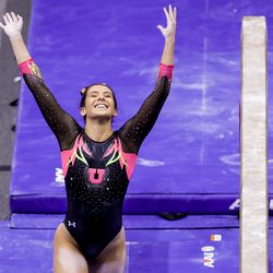 Utah's Alexia Burch celebrates after her dismount on the beam during a meet against Arizona at the Huntsman Center in Salt Lake City on Saturday, Jan. 23, 2021.