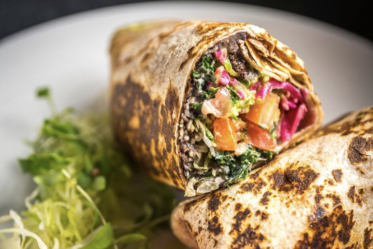 A colorful vegan burrito on a plate at Bar Verde at Plant City in Providence