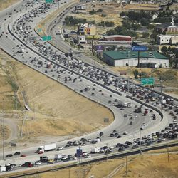 Motorists travel along I-15 at Point of the Mountain on Thursday, June 29, 2017.  A record-breaking 44 million people are expected to travel 50 miles or more during the holiday weekend.