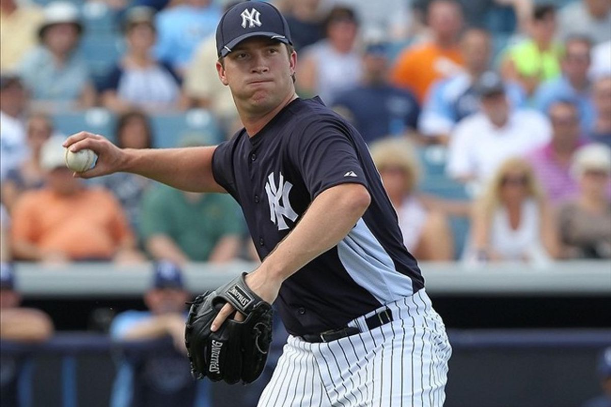 March 7, 2012; Tampa, FL, USA; New York Yankees pitcher Adam Warren (86) throws the ball to first for an out during spring training against the Tampa Bay Rays at George M. Steinbrenner Field. Kim Klement-US PRESSWIRE