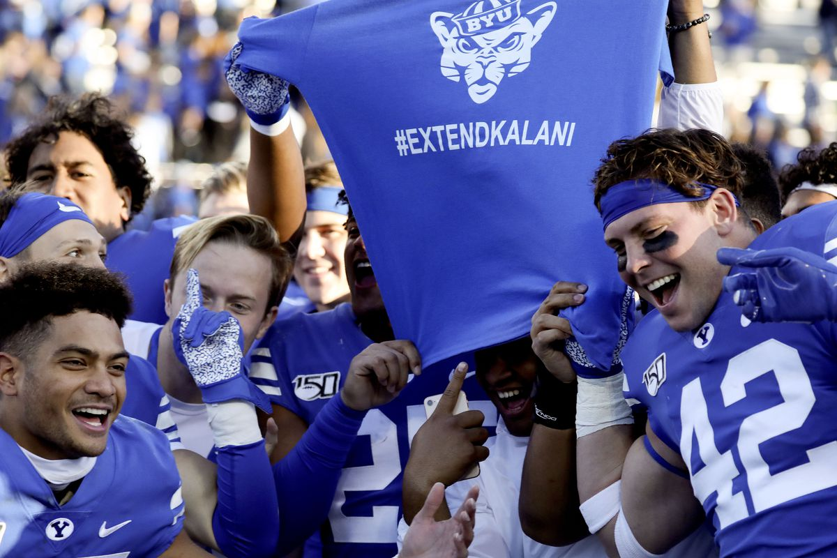 BYU football players display a T-shirt with #EXTENDKALANI after their win against Idaho State at LaVell Edwards Stadium in Provo on Saturday, Nov. 16, 2019.