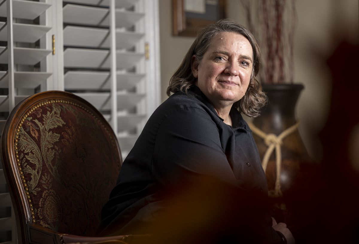 Andrea Wilko, who witnessed the second of two planes that crashed into the World Trade Center towers in New York on 9/11, poses for photos at her parents' home in Salt Lake City on Wednesday, Sept. 1, 2021.