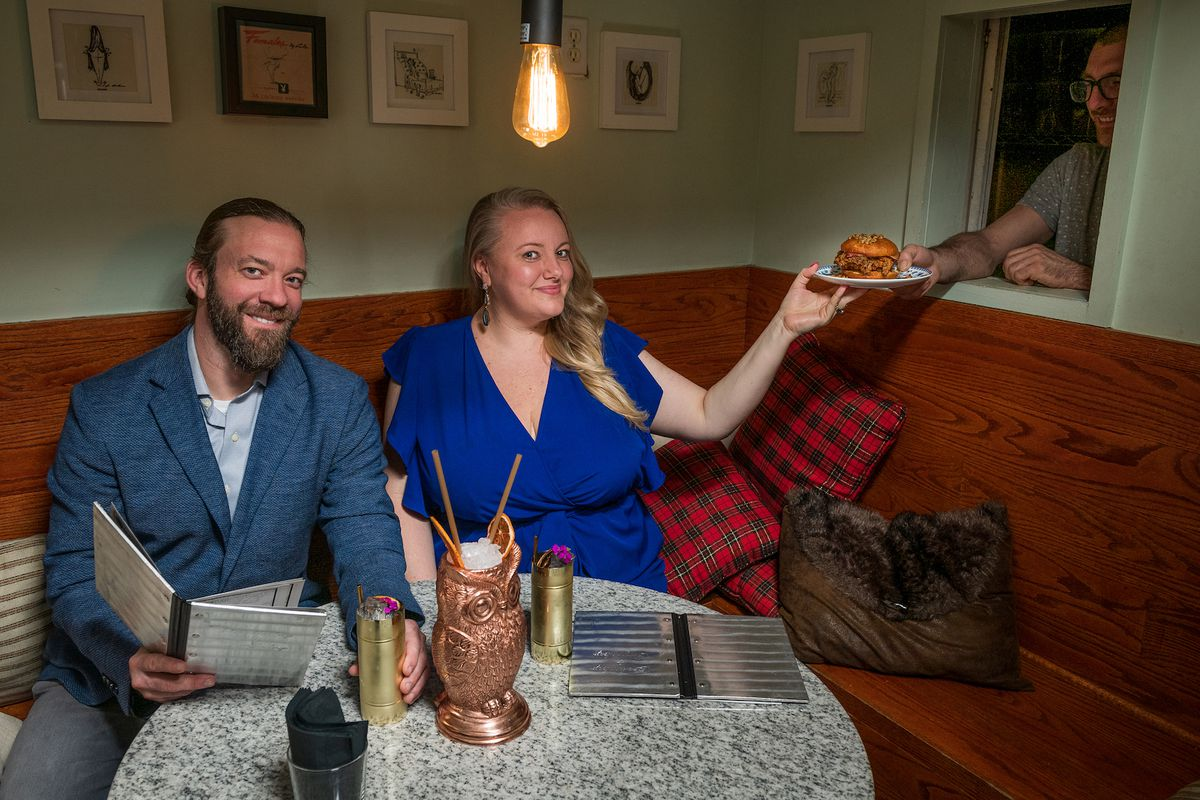 """Chefs Kyle Bailey, left, and Tiffany MacIsaac hold up """"the Top That"""" with Service Bar co-owner Chad Spangler."""
