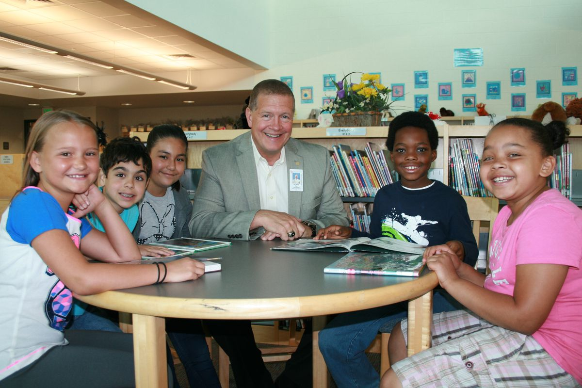 Harry Bull, superintendent of Cherry Creek schools, sits with students. (Photo courtesy of Cherry Creek School District)
