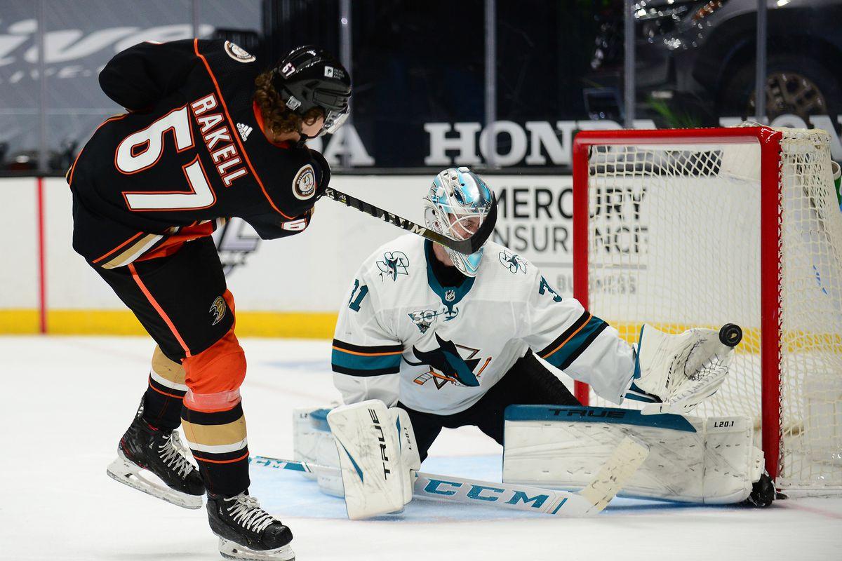 Anaheim, California, USA; San Jose Sharks goaltender Martin Jones (31) blocks a shot against Anaheim Ducks center Rickard Rakell (67) during the shootout period at Honda Center.