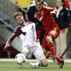 Fabian Espindola (right) of Real Salt Lake battles for control of the ball against Drew Moor of the Colorado Rapids during their MLS match up at Rio Tinto Stadium in Sandy Saturday, April 7, 2012.