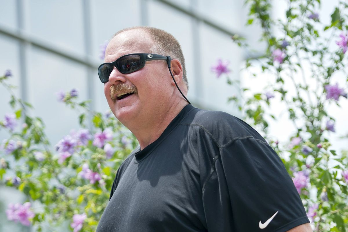 Kansas City Chiefs head coach Andy Reid smiles upon his arrival at the Chiefs training camp at Missouri Western State University in St. Joseph, Missouri, Monday, July 22, 2013.